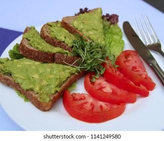 Avocado Toast with tomato. Healthy breakfast plate