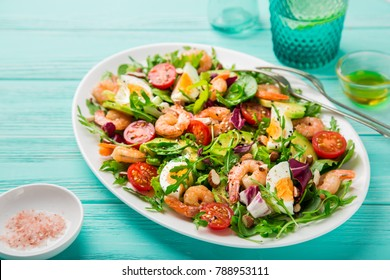 avocado, tomato, eggs and shrimps salad. selective focus