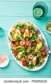 avocado, tomato, eggs and shrimps salad. Top view