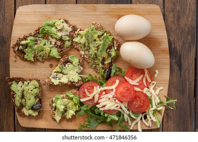 Avocado and vegemite smash on home made toast made of seeds cooked egg on top, healthy breakfast