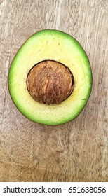 avocado with the wooden background.