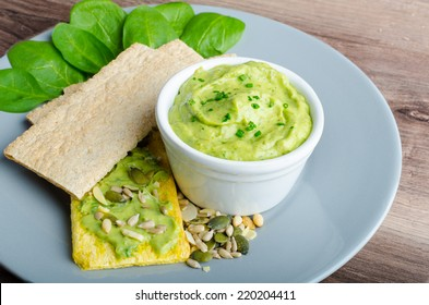 Avocado-Buttermilk Green Goddess Dip with fresh herbs and  Crispbread with a mixture of seeds