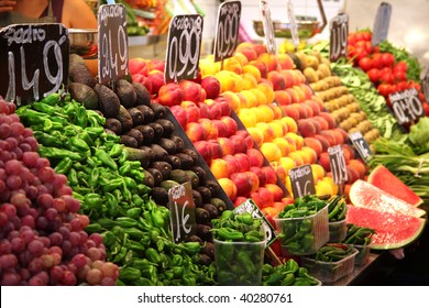 avocados and chilis stacked with other fruit on food market