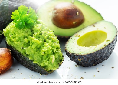 Avocados, cut open and filled with Avocado-dip