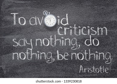 To avoid criticism say nothing, do nothing, be nothing - quote of ancient Greek philosopher Aristotle written on chalkboard with vintage stopwatch