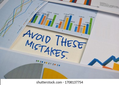Avoid These Mistakes write on a book isolated on Office Desk. Stock market concept
