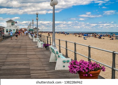 AVON BY THE SEA, NEW JERSEY - JUNE 30: A look down the boardwalk with many people on June 30 2007 in Avon by the Sea along the New Jersey coast.