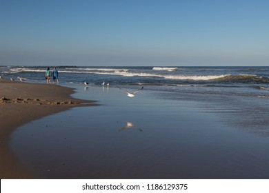 AVON BY THE SEA, NEW JERSEY-SEPTEMBER 16: A couple walks hand and hand along the beach on September 16 2018 in Avon by the Sea along the New Jersey coastline.
