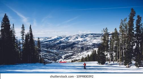 AVON, COLORADO - MARCH 22, 2017: A skier on the slopes at Beaver Creek ski resort.