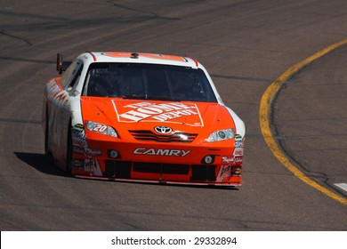 AVONDALE, AZ - APRIL 17: Joey Logano (20) drives his Toyota for qualification in the NASCAR Sprint Cup Series race at Phoenix International Raceway April 18, 2009 in Avondale, AZ.
