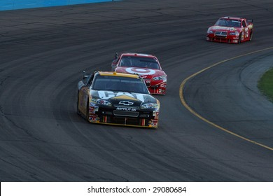 AVONDALE, AZ - APRIL 18: Jeff Burton (31) leads Juan Pablo Montoya out of turn two in the NASCAR Sprint Cup Series race at Phoenix International Raceway April 18, 2009 in Avondale, AZ.