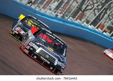 AVONDALE, AZ - FEB 25: Timothy Peters (17) takes hot laps during a practice session for the Lucas Oil 150 race on Feb. 25, 2011 at the Phoenix International Raceway in Avondale, AZ.