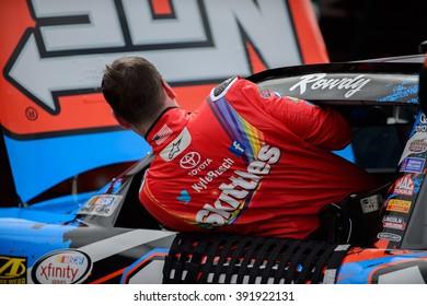 AVONDALE, AZ - MAR 11: Kyle Busch getting out of the car at the NASCAR Xfinity Series Axalta 200 at Phoenix International Raceway in Avondale, AZ on March 11, 2016