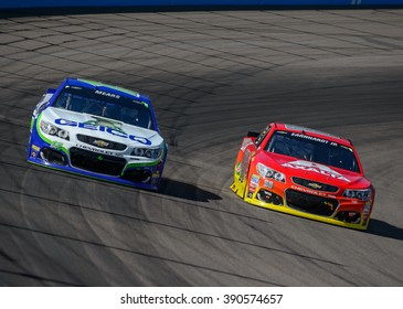 AVONDALE, AZ - MAR 13: Dale Earnhardt Jr passes Casey Mears at the NASCAR Sprint Cup Good Sam 500 race at Phoenix International Raceway in Avondale, AZ on March 13, 2016
