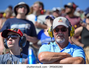 AVONDALE, AZ - MAR 13: Fans, father and son, at the NASCAR Sprint Cup Good Sam 500 race at Phoenix International Raceway in Avondale, AZ on March 13, 2016