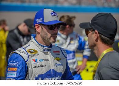 AVONDALE, AZ - MAR 13: Jimmie Jonson (left) talking to a friend a the NASCAR Sprint Cup Good Sam 500 race at Phoenix International Raceway in Avondale, AZ on March 13, 2016