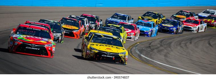 AVONDALE, AZ - MAR 13: Kyle Busch (left) and Carl Edwards lead the restart at the NASCAR Sprint Cup Good Sam 500 race at Phoenix International Raceway in Avondale, AZ on March 13, 2016
