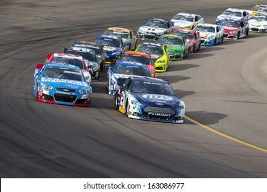 Avondale, AZ - Nov 10, 2013:  The NASCAR Sprint Cup teams take to the track for the AdvoCare 500 race at the Phoenix International Raceway in Avondale, AZ on Nov 10, 2013.