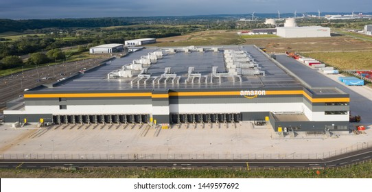 AVONMOUTH UK - JULY 13, 2019: Amazon warehouse & distribution centre building handles online shopping retail internet & technology business development