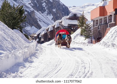 Avoriaz, France - April 18, 2018. A horse drawn sleigh or carriage is drawn through the ski resort transporting tourists around the town centre and to hotels