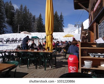 AVORIAZ, FRANCE - FEB 19, 2018 - Skiers enjoy lunch served outdoors in the Portes du Soleil town of Les Lindarets, France