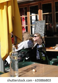 AVORIAZ, FRANCE - FEB 21 - Skiers enjoy lunch outdoors in the sun  on Feb 21, 2012 in Avoriaz, France