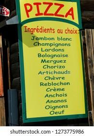 AVORIAZ, FRANCE - FEB 25, 2012 - Pizza menu sign at an outdoor restaurant in Avoriaz, France