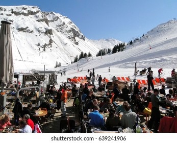 AVORIAZ, FRANCE - FEB 25, 2012 - Skiers enjoy lunch outdoors in the sun  on Feb 25, 2012 in Avoriaz, France