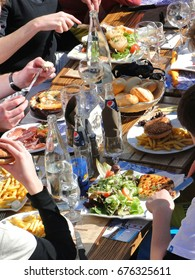 AVORIAZ, FRANCE - FEB 25, 2012 - Skiers enjoy lunch outdoors in the sun Avoriaz, France
