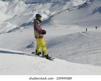 AVORIAZ, FRANCE - FEB 25 - Colorfully dressed snow boarder prepares for the next ride  on Feb 25, 2012 in Avoriaz, France