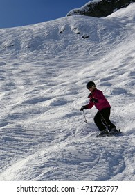 AVORIAZ, FRANCE - MAR 4, 2013  - Skier descends mogul field in the  high alpine ski area in the French alps