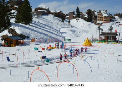 Avoriaz, Haute-Savoie / France - March 17, 2015: Children learning to ski in the infant ski school in the center of Avoriaz in the Portes du Soleil ski area of the French Alps.