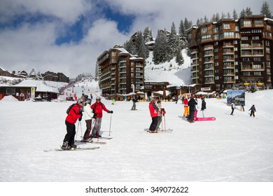 Avoriaz,Haute-Savoie / France - March 19th 2013: Skiers and boarders stand talking near the cable car exit and the bottom of the ski resort of Avoraiz.