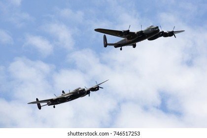 Avro Lancaster FM213 of Canadian Warplane Heritage and PA474 of the Battle of Britain Memorial Flight during their first flight together at RAF Coningsby, England, 13th August 2014