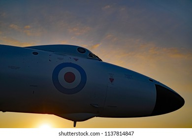 AVRO Vulcan at sunset. Nose view i n the evening sky.