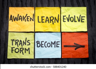 awaken, learn, evolve, transform and become - inspirational handwriting on  sticky notes against black lokta paper