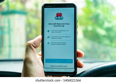 awang, Selangor / Malaysia - May 24th 2019: A driver is using WAZE app for driving direction.  WAZE has become an essential part of a motorist's daily routine for driving guidance and assistance.