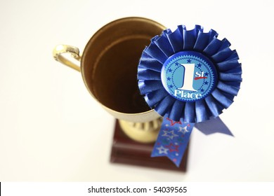 award badge and the trophy on the plain background