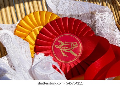 Award rosettes for winner in equestrian sport with red and yellow colors