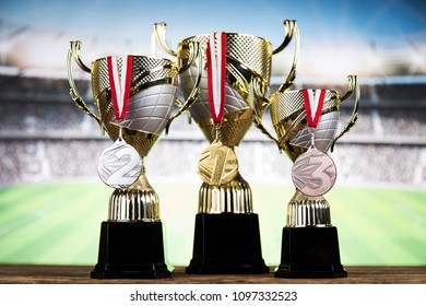 Award winning and championship concept, trophy cup on sport background
