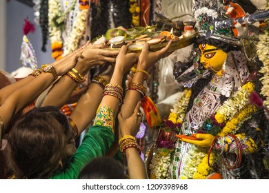 Award winning community puja commite gather with their Durga Idols and participant to take part in  carnival in Kolkata.