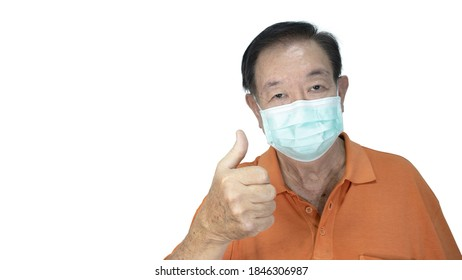 Awareness concept to ware mask, The oldman shown how correct way of using medical face masks to protect from coronavirus(covid-19) and thumbs up, isolated on white background