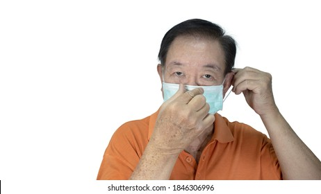 Awareness concept to ware mask, The oldman shown how correct way of wearing medical face masks to protect from coronavirus(covid-19), isolated on white background