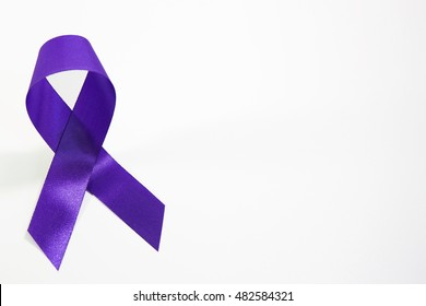 Awareness violet or purple ribbons of common cancer for symbol of testicular cancer or lymphoma for people protect on white background and left side