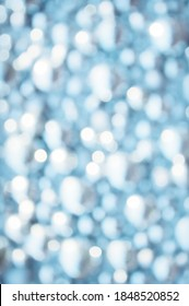 Awe beautiful christmaslight twinkly blue color dust glitz card copyspace area. Bright glittery de focus art soft sphere shape. Close-up view with space for text on dark gray merry xmas glowball scene