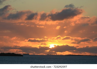 Awe inspiring sunset over the ocean capturing sun rays, fiery skies and dramatic clouds Variation #3 - Shutterstock ID 723292597