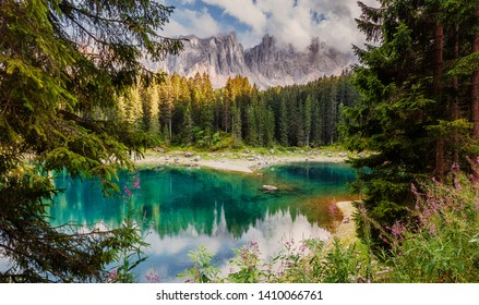 Awesome alpine highlands with dramatic sky. Scenic image of fairy-tale Landscape in Dolomites alps. incredible view majestic Dolomite alps with reflection on Lake Karersee, Lago di Carezza. panorama