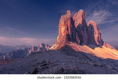 Awesome alpine highlands during sunrise. Amasing nature landscape. Tre Cime di Laveredo, three spectacular mountain peaks with colorful sky,  Dolomites Alps, South Tyrol, Italy. Picture of wild area