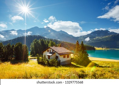 Awesome alpine lake Champfer in beautiful summer day. Location place Silvaplana village, Swiss alps, district of Maloja, Europe. Scenic image of famous european resort. Discover the beauty of earth.