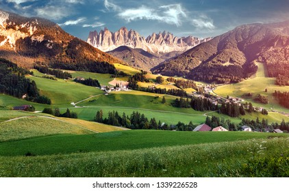 Awesome alpine Landscape. Famous best alpine place of the world, Santa Maddalena (St Magdalena) village with magical Dolomites mountains in background, Val di Funes valley, Trentino Alto Adige. Italy